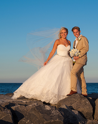 Bride and Groom on Rocks at the beach